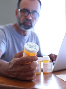 HealthSmartRx person reading pill bottle